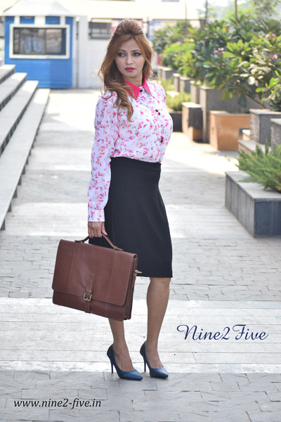 White & Pink Printed Georgette Shirt. Full Sleeves With Cuff. Dark Pink Shirt Collar. Buttoned Front. It can be machine washed in cold water. Model of 5 feet 4 inches is wearing S Size