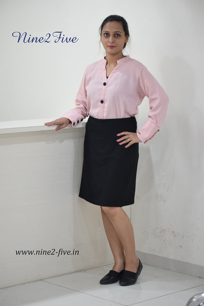 Pastel Pink Formal Shirt. Full Sleeves. Long Cuff With Black Fabric Buttons. Chinese Collar. Buttoned Front. Regular Fit Shirt. It can be machine washed in cold water. Model of 5 feet 4 inches is wearing S Size