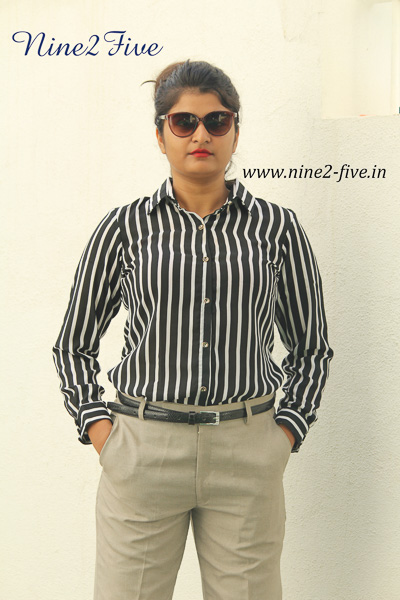 Black & White Striped Polymoss Formal Shirt. Full Sleeves Cuff. Shirt Collar. Buttoned Front. Regular Fit Shirt. It can be machine washed in cold water. Model of 5 feet 4 inches is wearing S Size
