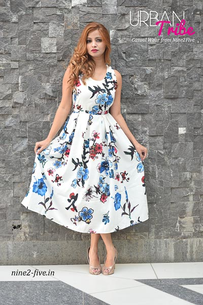 White Floral Print Heavy Polymos Midi Dress. Crepe Lining. Box Pleats. Sleeveless. Round Neck. It can be machine washed in cold water. Model of 5 feet 4 inches is wearing S Size