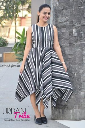Black & White Heavy Crepe Handkerchief Style Dress. Sleeveless. Round Neck. It can be machine washed in cold water. Model of 5 feet 4 inches is wearing S Size