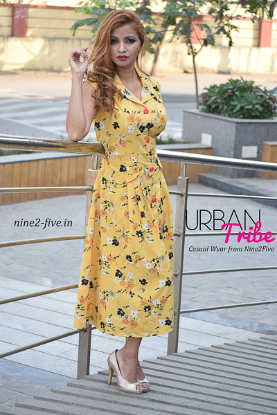 Mango Colour Floral Print Pleated Polymoss Midi Dress. Sleeveless. Wing Collar. Polymoss Fabric Buttons On Front. . It can be machine washed in cold water. Model of 5 feet 4 inches is wearing S Size