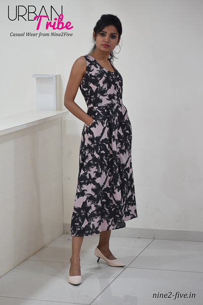 Greyish Pink Printed Polymos Midi dress. Sleeveless. Round Neck. Two Side Pockets With Fancy Buttons. It can be machine washed in cold water. Model of 5 feet 4 inches is wearing S Size