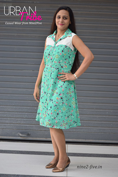 Floral Print Light Green Georgette Shirt Collar Short Dress . White Yoke. Sleeveless. Crepe Lining. It can be machine washed in cold water. Model of 5 feet 4 inches is wearing S Size